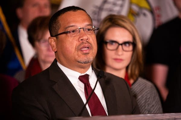 Keith Ellison speaks to media inside the State Capitol.