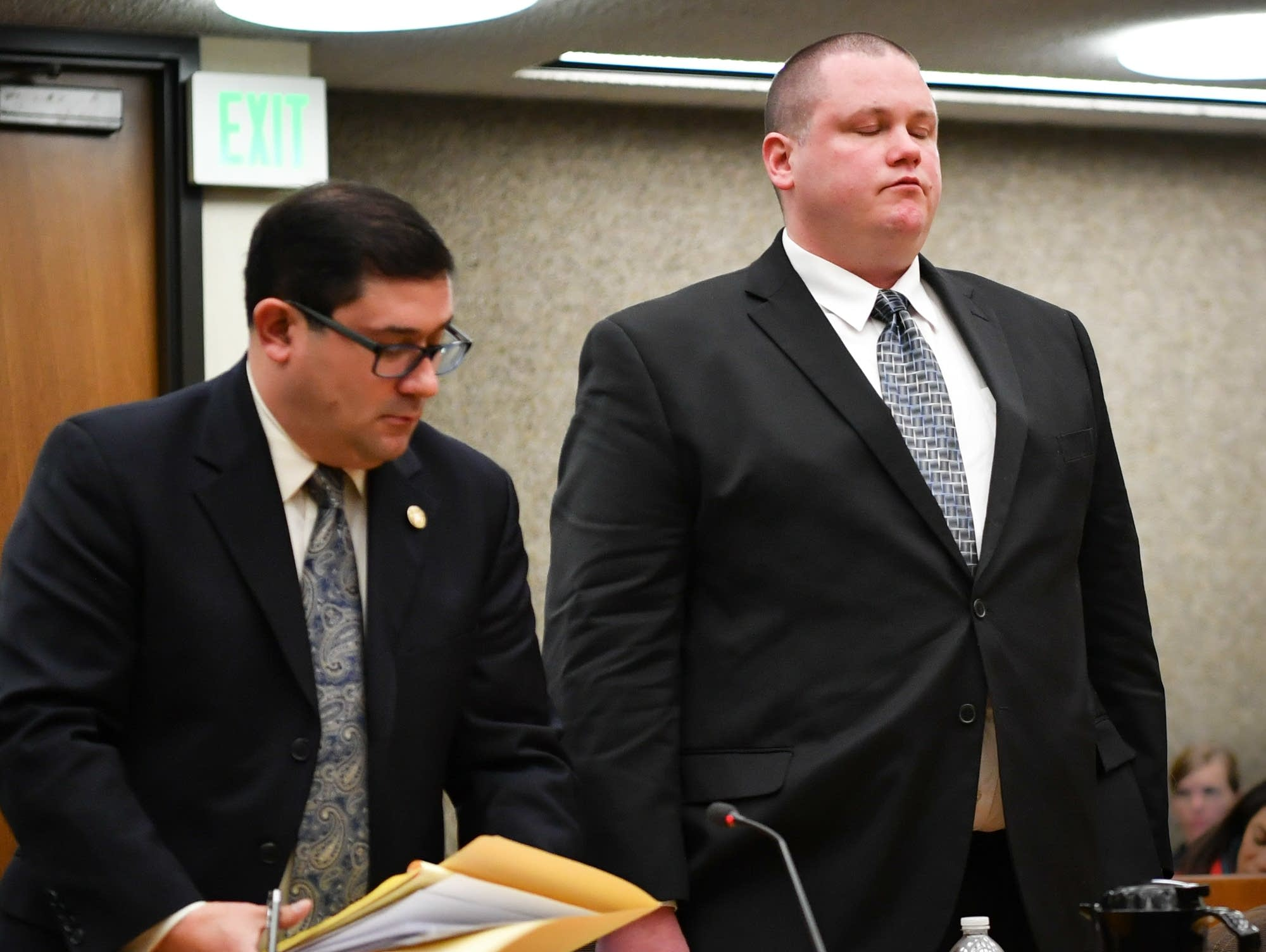 Ex-Mpls. cop Christopher Reiter listens as his sentence is handed down.
