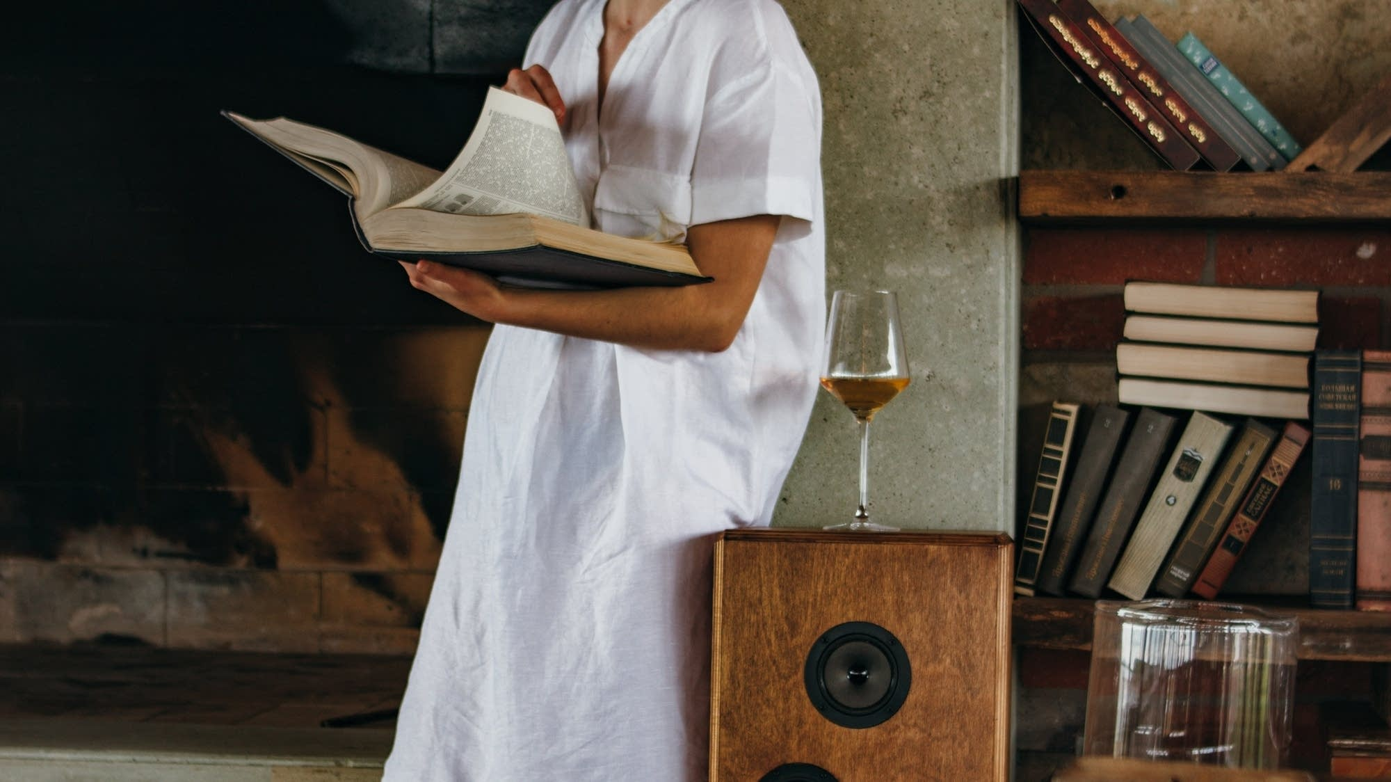 Woman drinking wine and reading