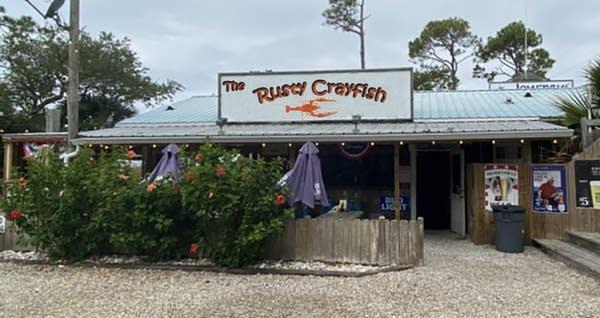 "Fisherman's style divebar w/ photoshopped sign: ""The Rusty Crayfish"""