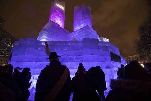 The crowd gets an up close look at the ice palace at the lighting ceremony.