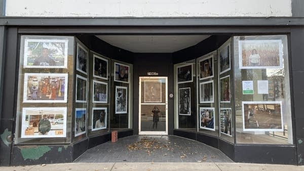A storefront with artwork in the windows