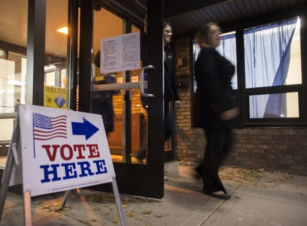 People exit a polling place in Minneapolis one election night.