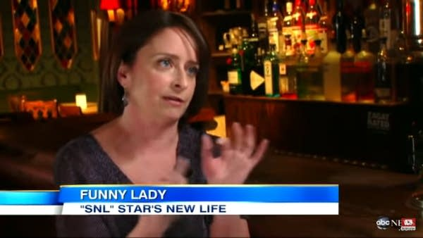 "Rachel Dratch on TV news w/ text ""Funny Lady: SNL Star's New Life"""