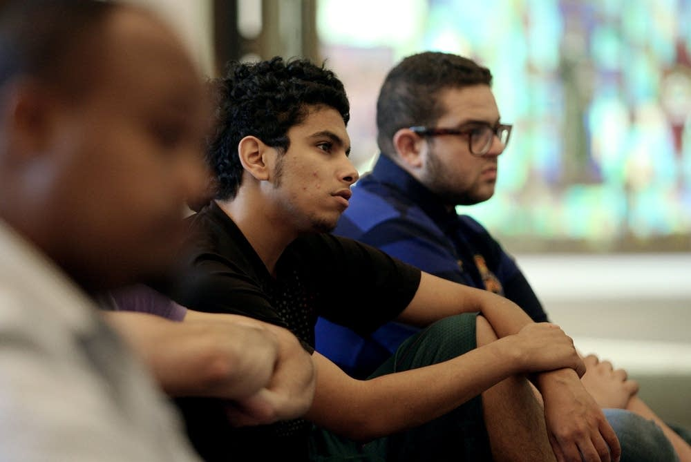 Mohammad Ahmad listens during prayer service
