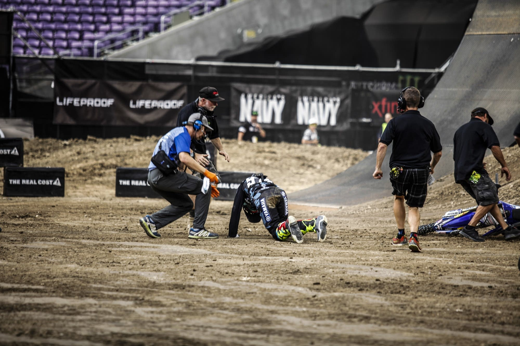 Jarryd McNeil falls from his bike as he lands from his jump.
