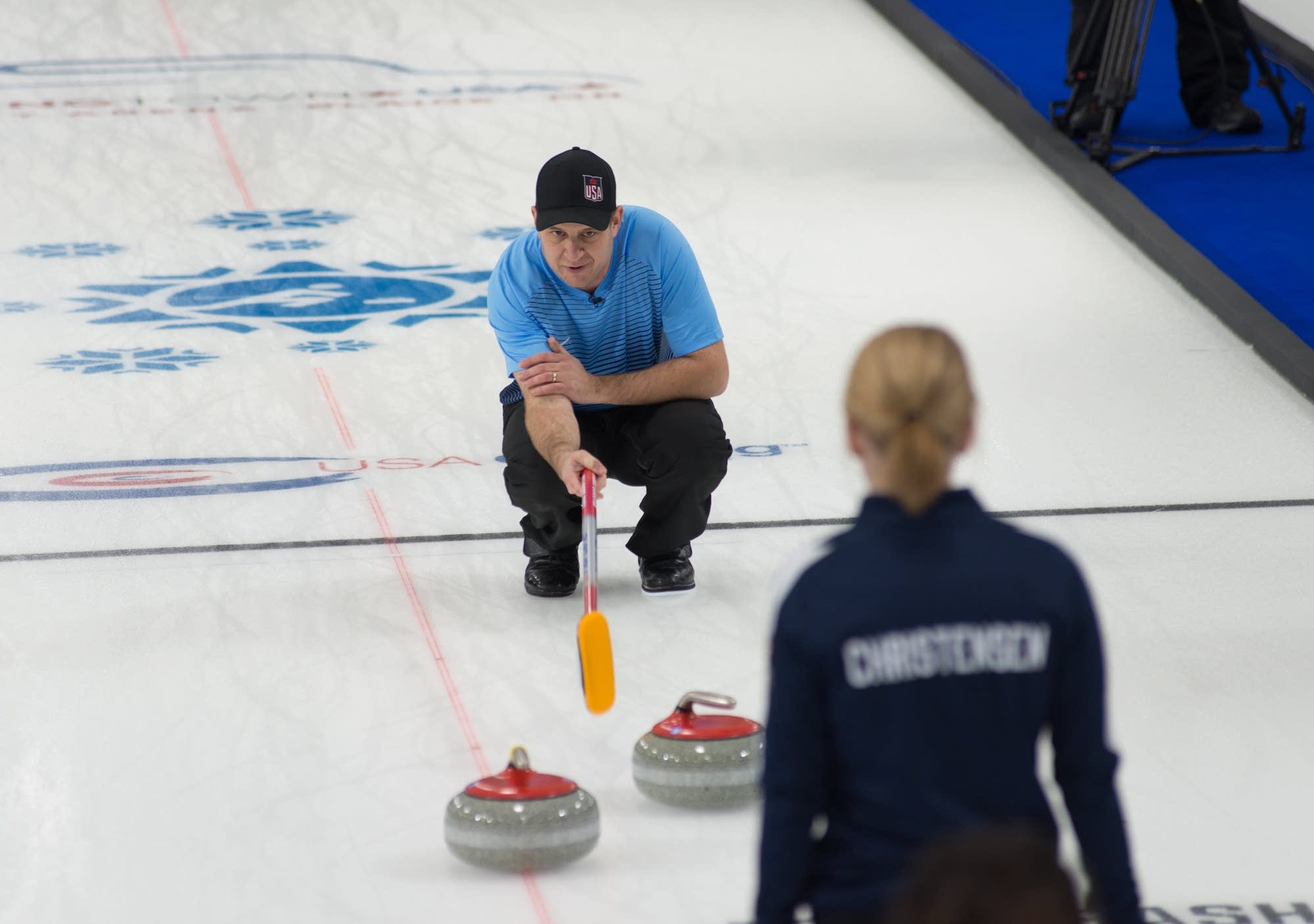 John Shuster consults with teammate Cory Christensen during the final.