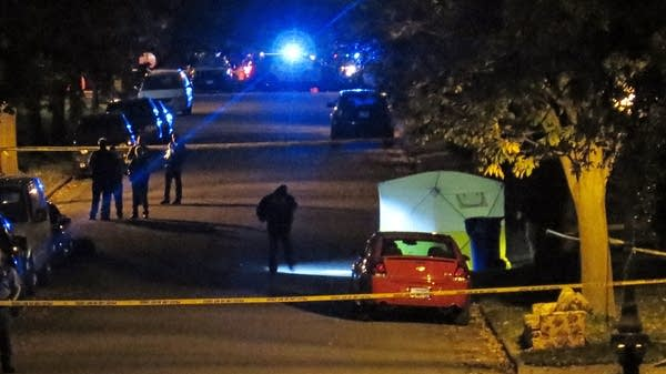 Investigators set up a tent along Euclid St. in St. Paul.