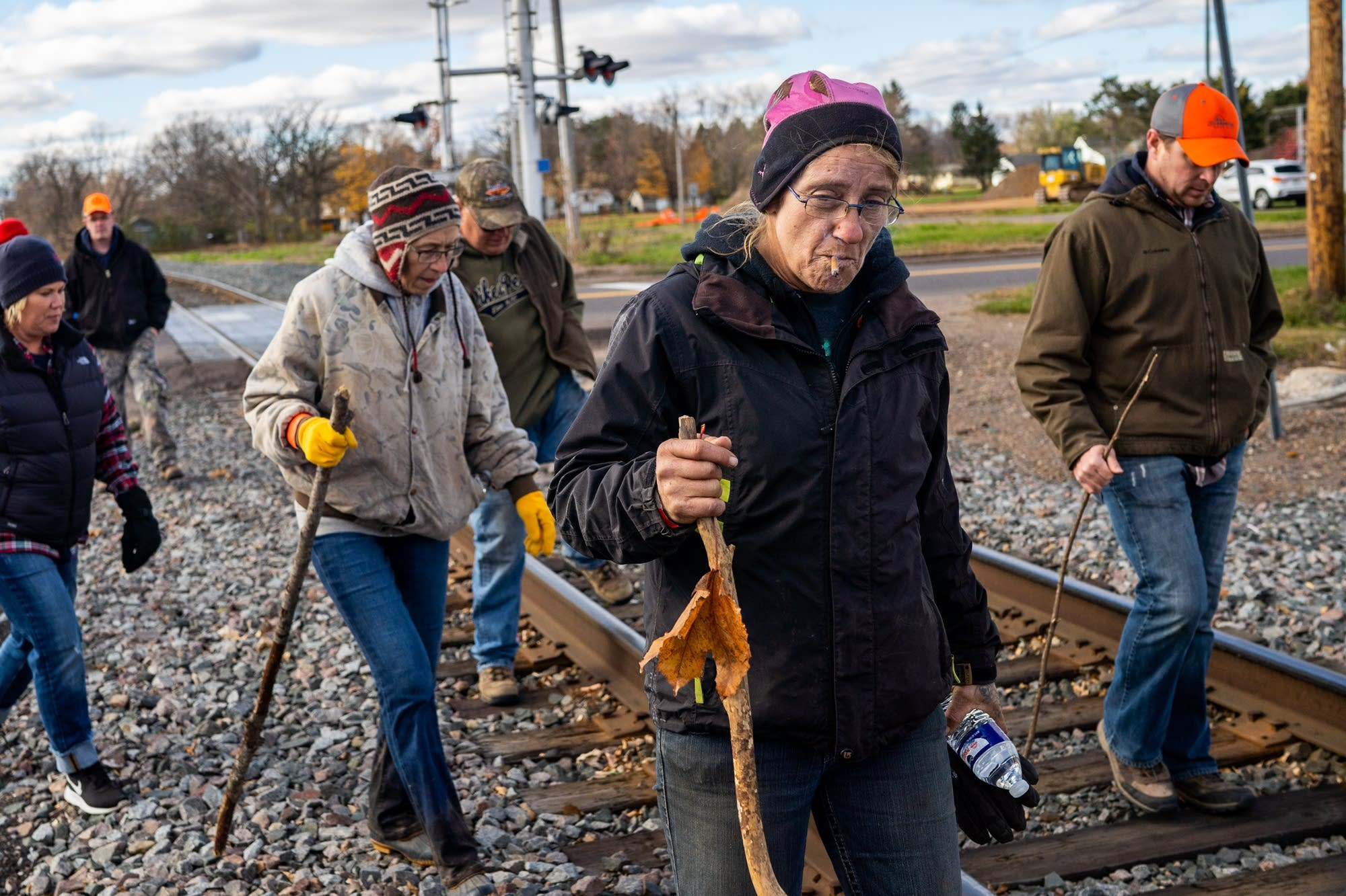 Stacy Quist of Bruce, Wisc. walks along train tracks.