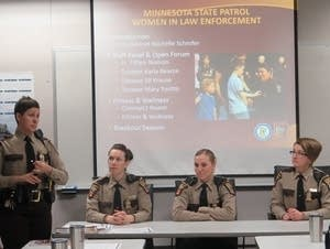Lt. Tiffani Nielsen (left) speaks during a State Patrol recruiting event