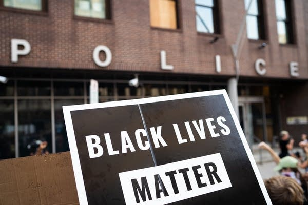 A Black Lives Matter sign in front of a police station.