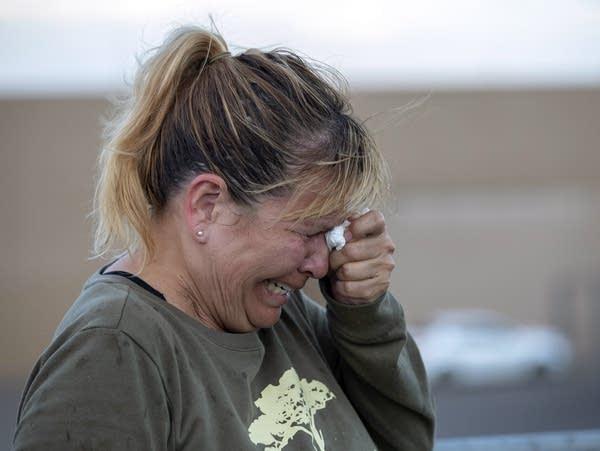 Edie Hallberg cries while speaking to police