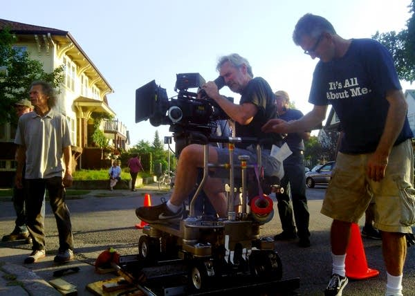 Bill Eigen, left, works with the film crew.