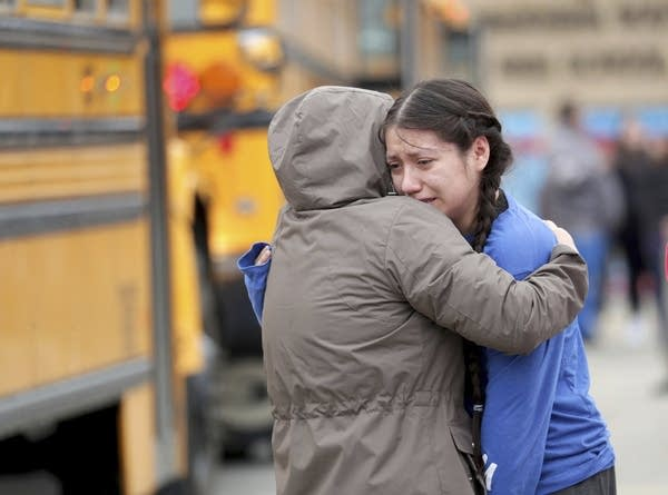 A student hugs her mother after a shooting incident at her school.