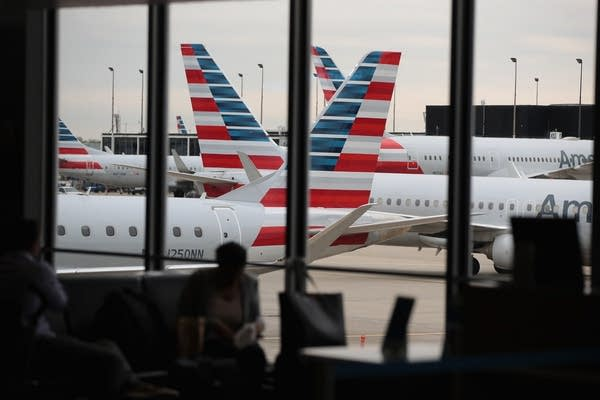 American Airlines aircraft sit at gates at O'Hare International Airport