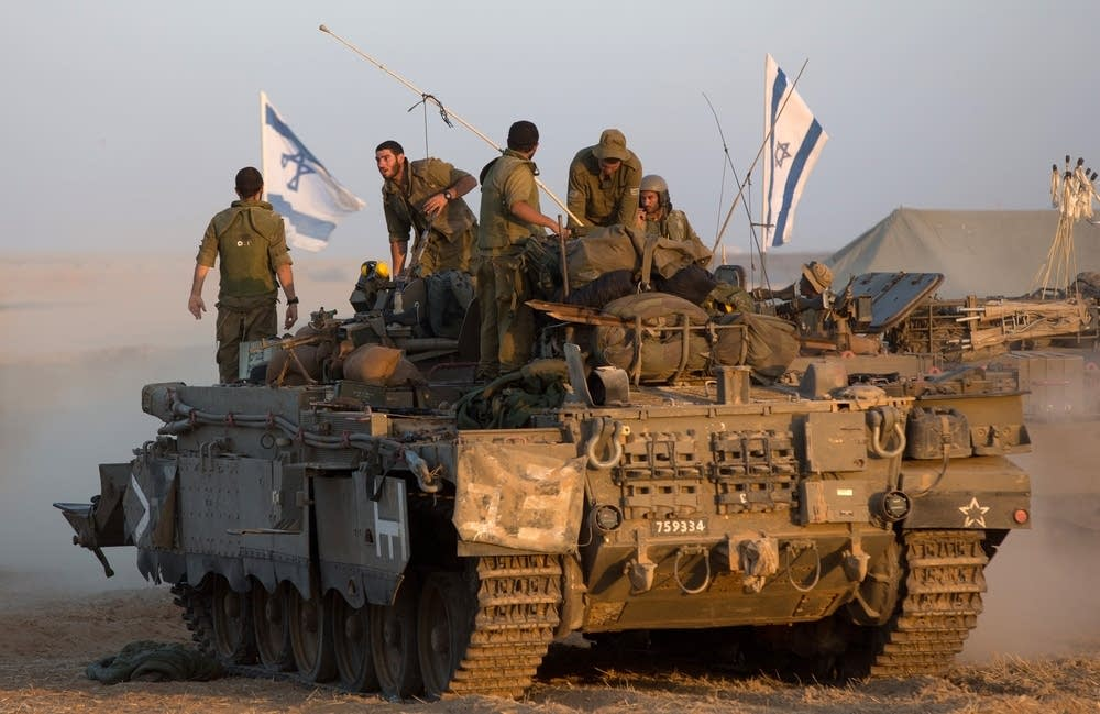 Israeli soldiers gather in an army deployment area