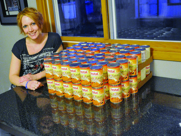 Angie Probst shows off her stash of Festal pumpkin pie filling in 2015.