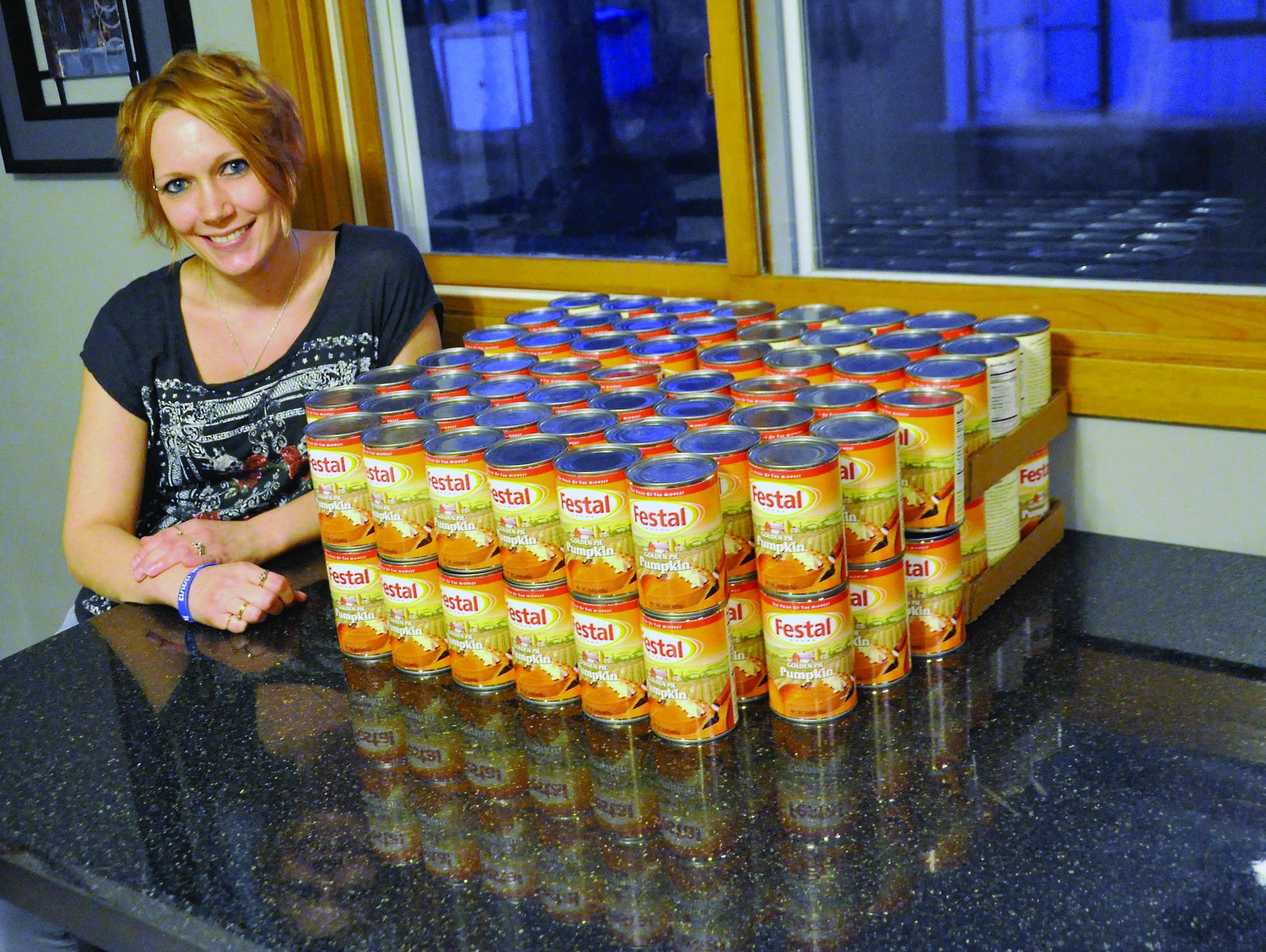 Angie Probst shows off her stash of Festal pumpkin pie filling in 2015.