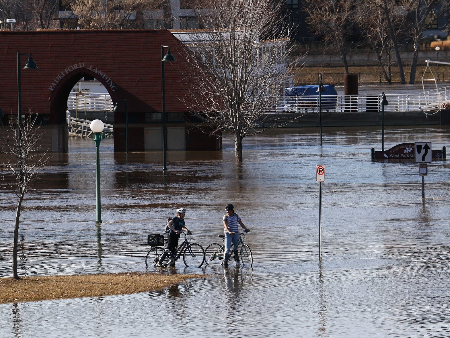 The Mississippi River overflows its banks in St. Paul