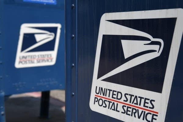 The United States Postal Service logo on a mailbox.