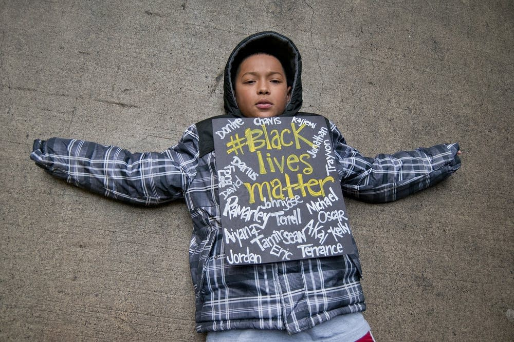 Taye Clinton laid in the street outside the mall.