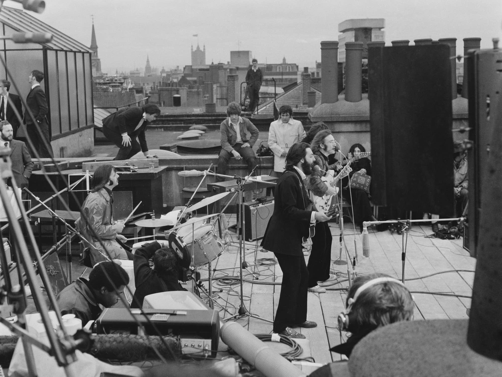 The Beatles performing on the roof of the Apple Organization building.