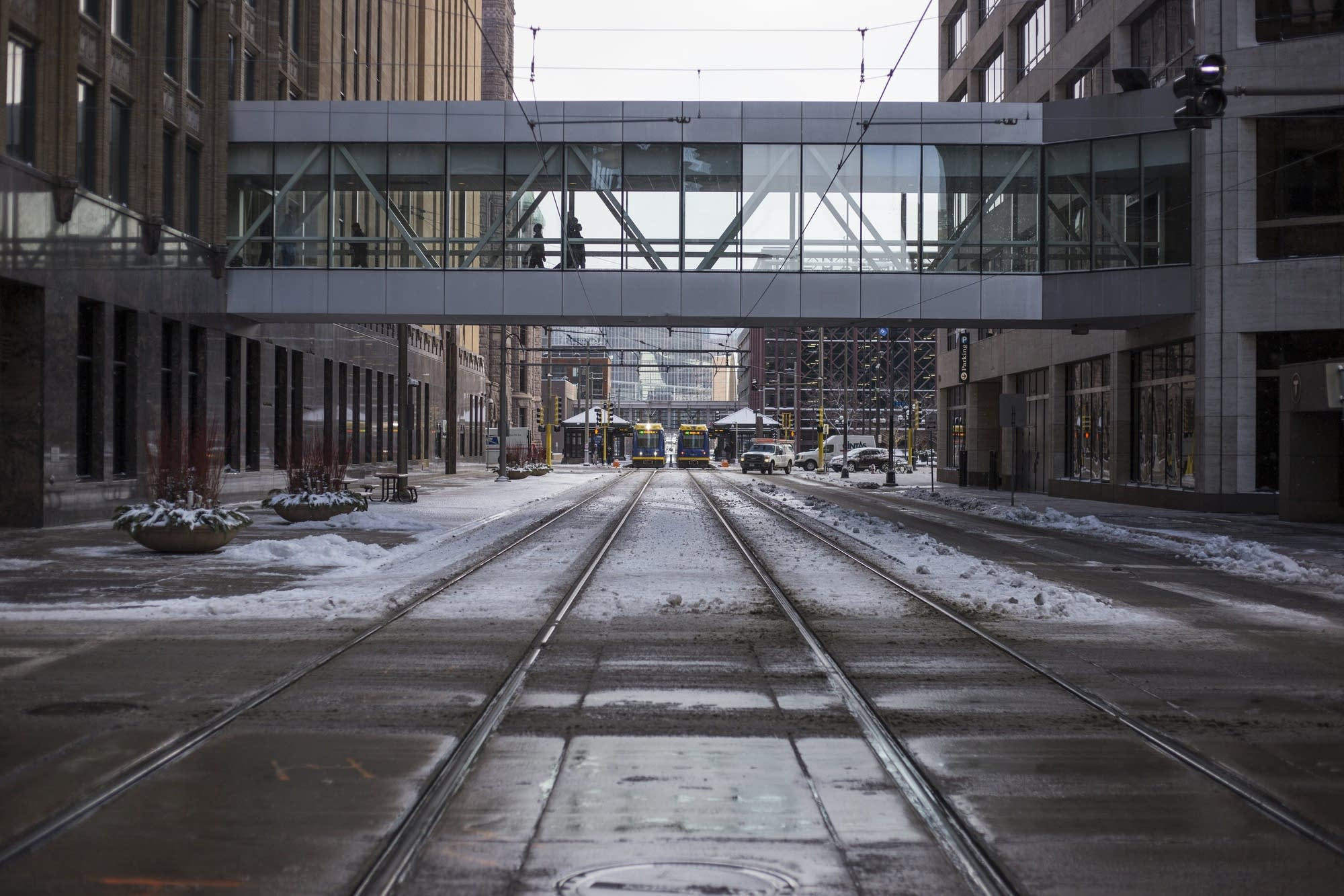 Snow in downtown Minneapolis stays put for the first time this season.