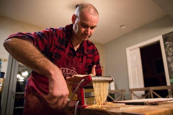 Bazak Sharon cuts ramen dough.