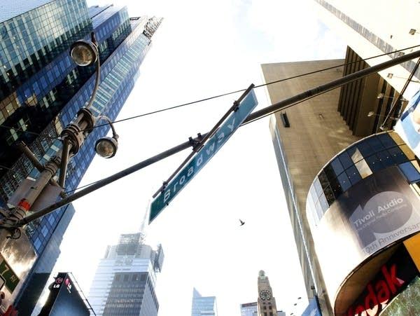 A street sign hangs over Broadway