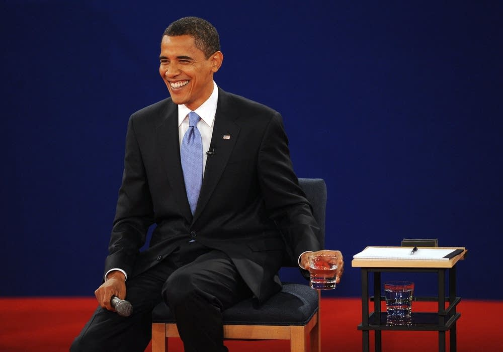Democrat Barck Obama smiles during the debate