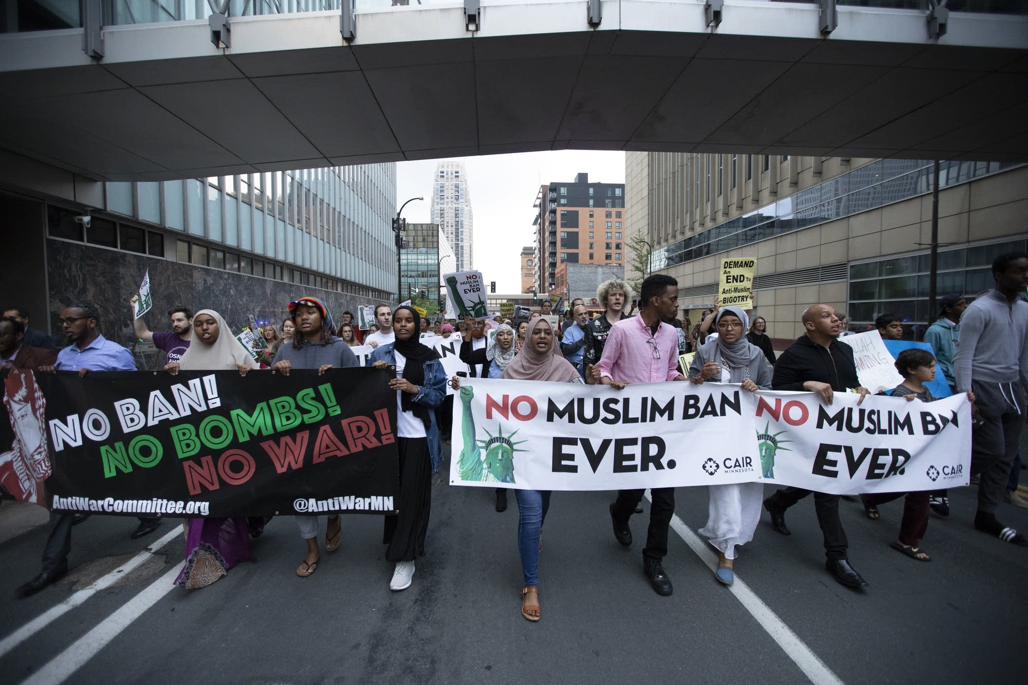 Travel ban protesters march down the street in Minneapolis.