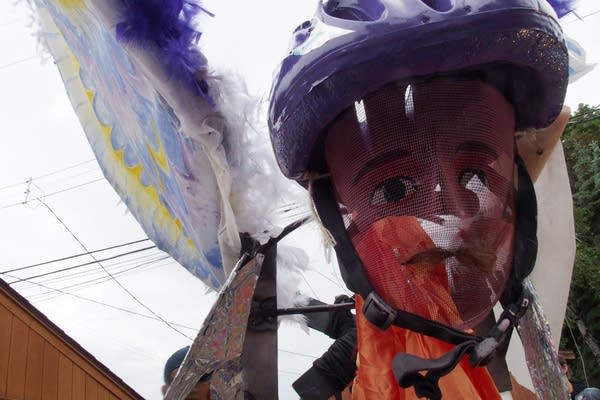 """""""The Biker,"""" a sculpture by Victor Yepez, wears a carnival mask."""