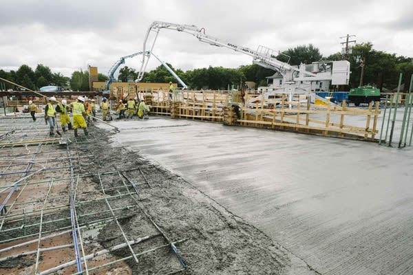 Concrete dries at the Thor Construction headquarters site.