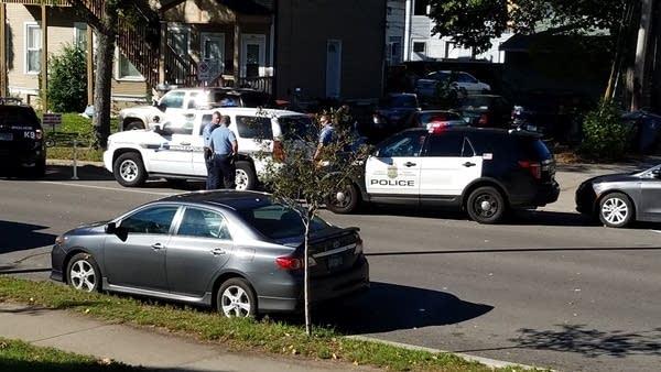 Police watch crime scene technicians