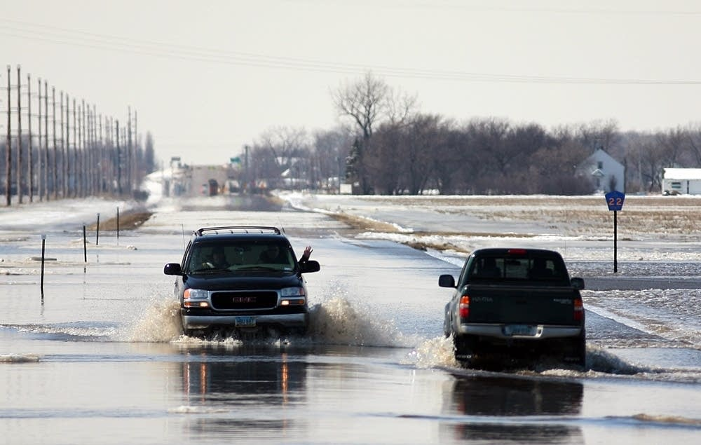 Drivers on a flooded street