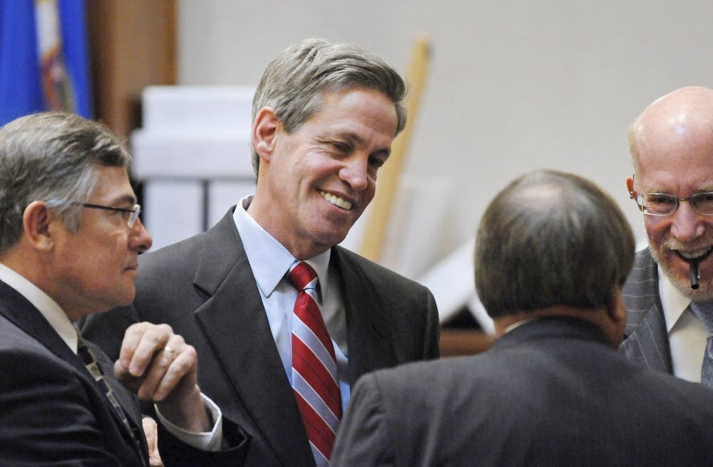 Norm Coleman visits with his attorneys
