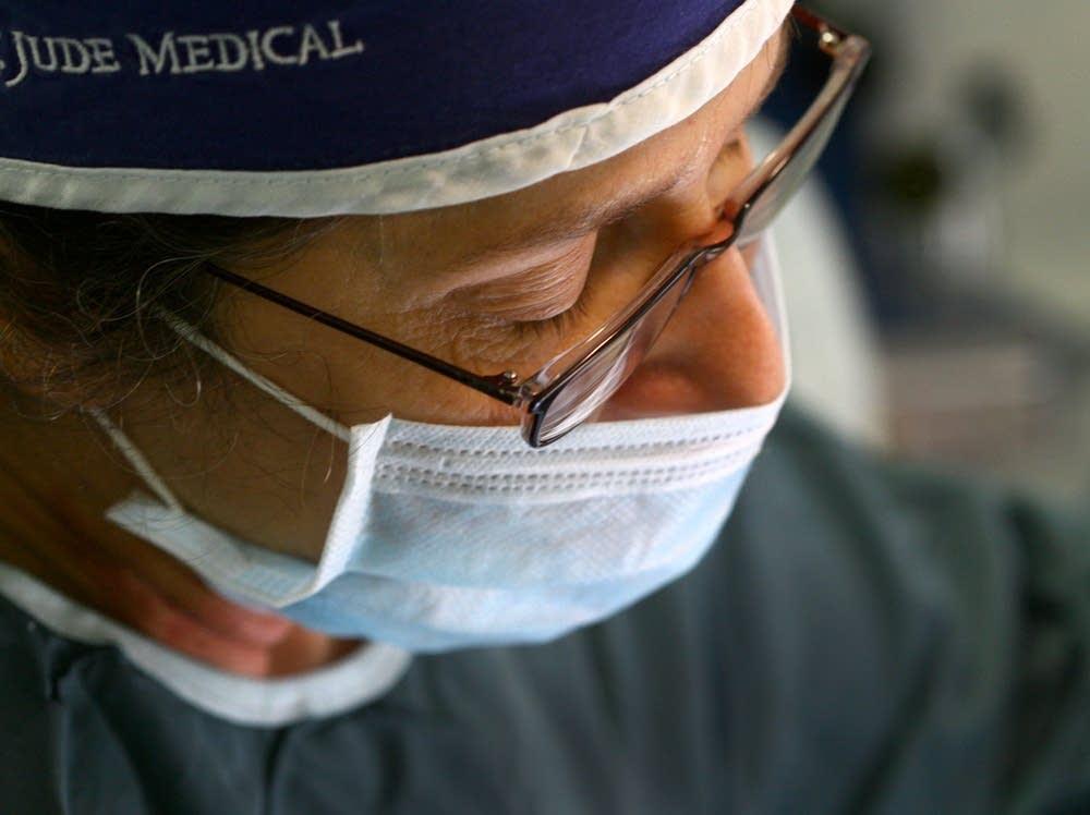 Kim Culbertson performs surgery