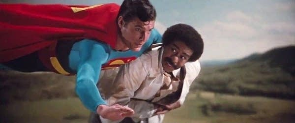 Superman flying and holding Richard Pryor's character in movie
