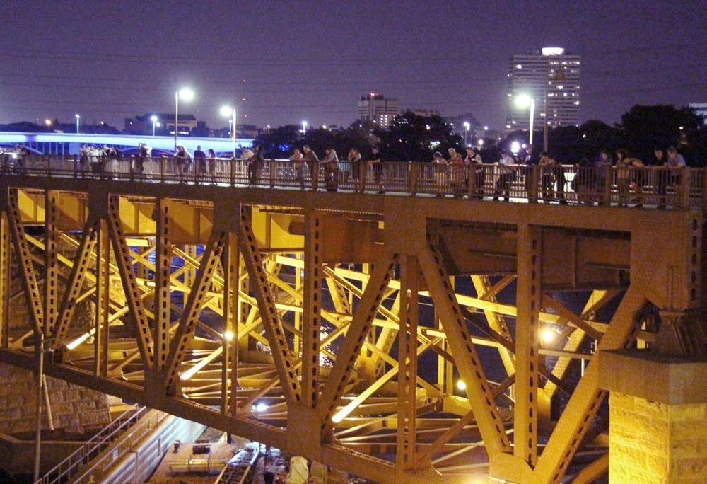 Spectators gathered on the Stone Arch Bridge.