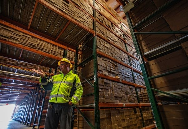 Thousands of boxes of core samples in a warehouse tower over Dean Debeltz.