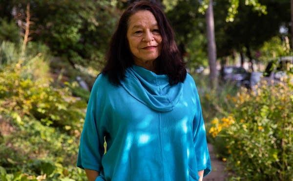 Marcie Rendon stands for a portrait photo