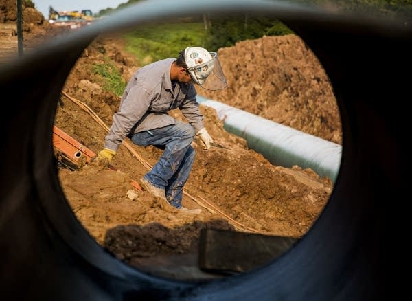 A contractor works on a replacement for Enbridge's Line 3 pipeline.