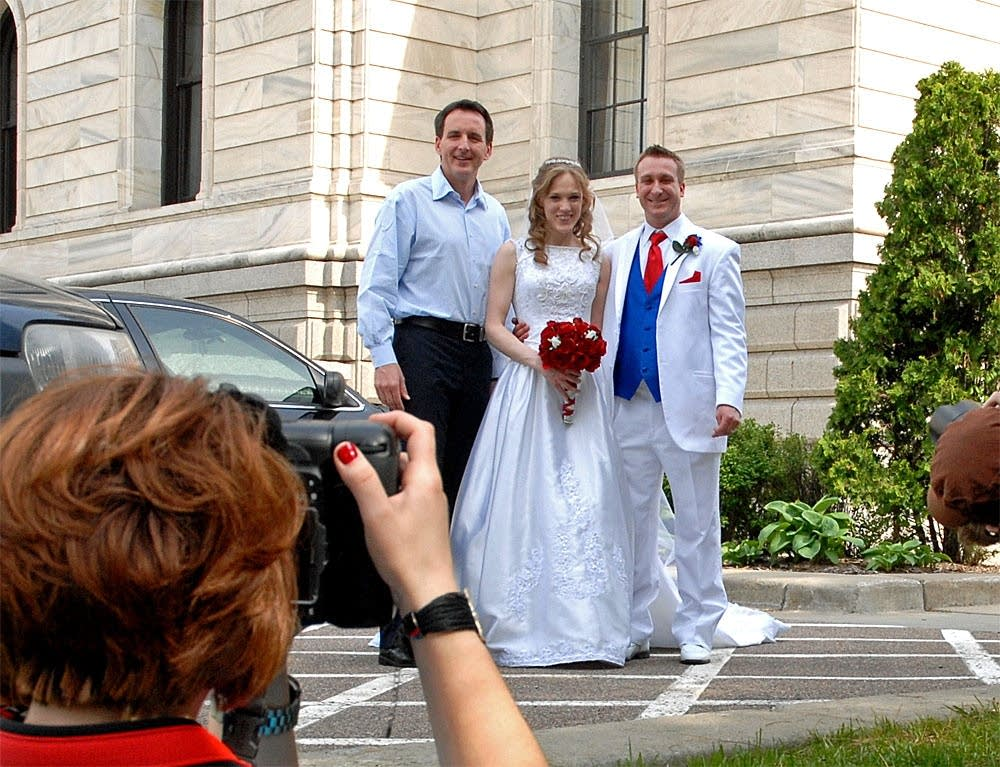 Governor posed with newlyweds