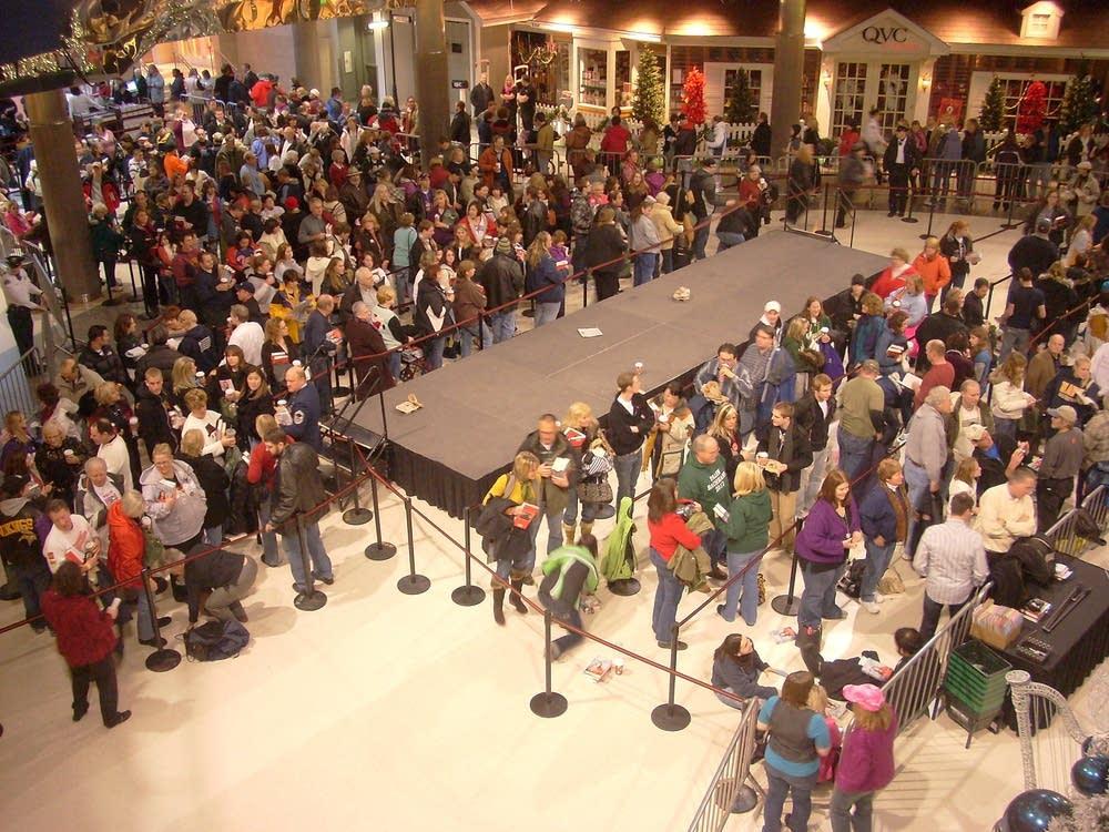 Fans line up inside
