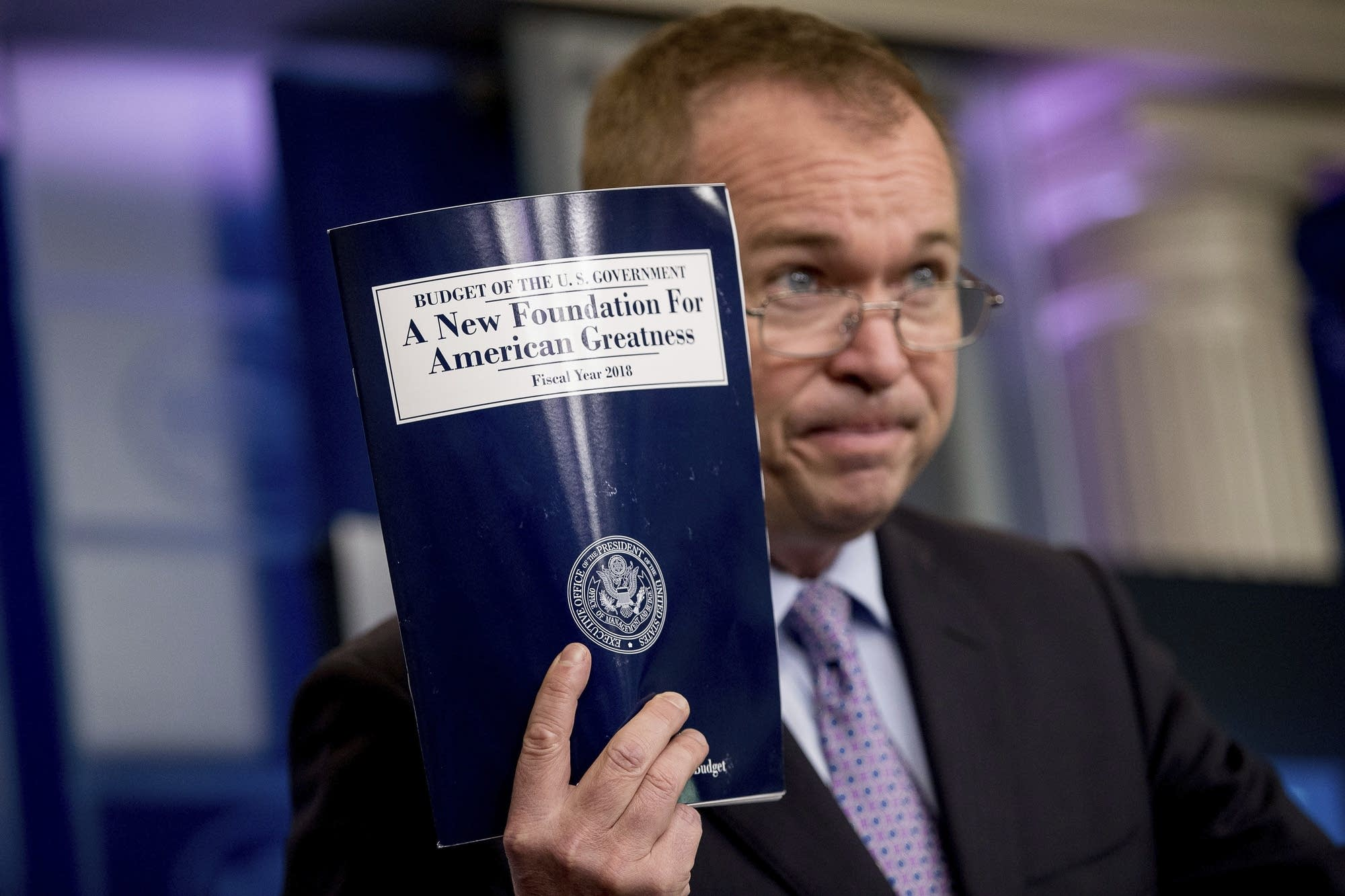 Budget Director Mick Mulvaney holds up a copy of proposed budget.