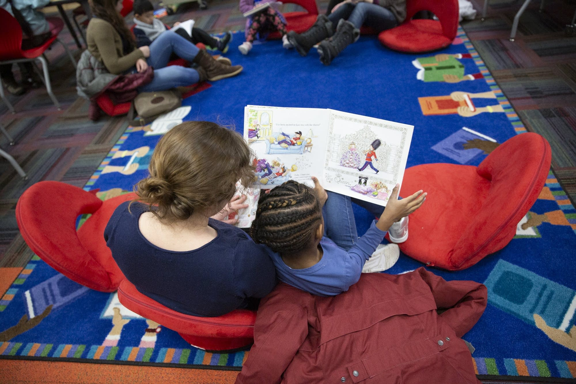 Book Buddies volunteer Emily McPhillips reads with a first grader.