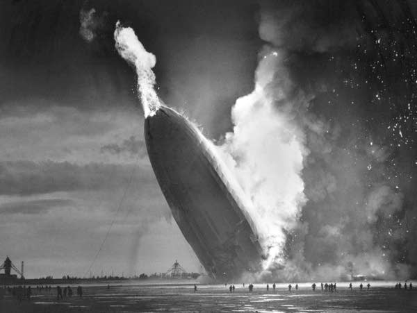The German dirigible Hindenburg crashes to earth in flames