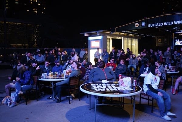 Fans watch the NCAA men's basketball championship game on Nicollet Mall