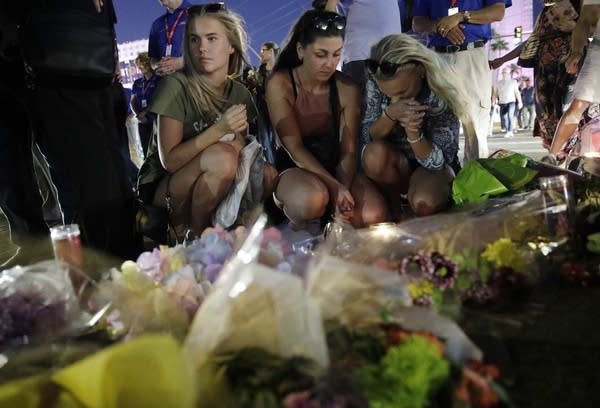 People at a memorial for the victims of the Las Vegas shooting.