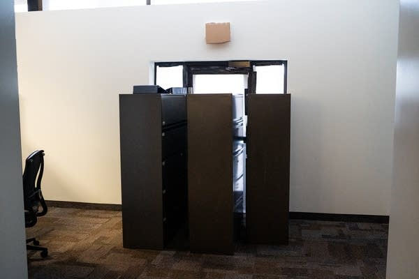 File cabinets barricade a door.